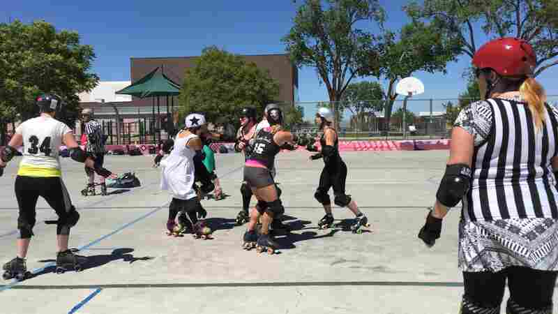 A roller derby scrimmage in Albuquerque, N.M. Three of the women participating — Lauren Winkler, Leigh Featherstone and Holly Chamberlin — have kept their support of Hillary Clinton quiet.