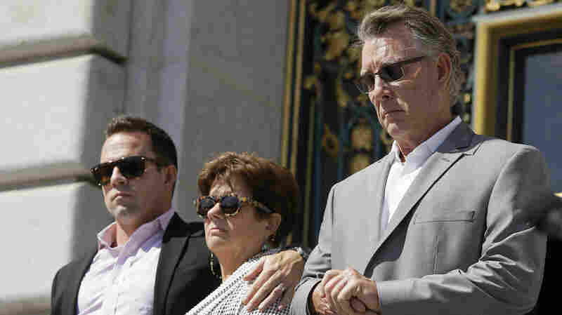 The family of Kate Steinle is suing San Francisco and two federal agencies over her killing last year. In this 2015 photo are Brad Steinle, Liz Sullivan and Jim Steinle, her brother, mother and father.