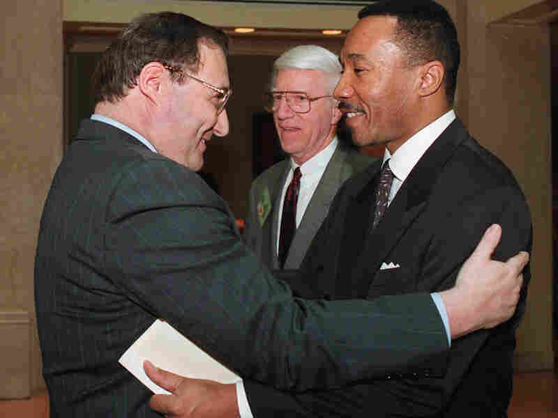"NAACP President and Chief Executive Officer Kweisi Mfume, right, embraces Anti-Defamation League National Director Abe Foxman in Washington prior to a discussion entitled ""Black/Jewish Relations and the Future of the East Civil Rights Movement"" on April 22, 1996. Foxman led the ADL from 1987 to 2015."