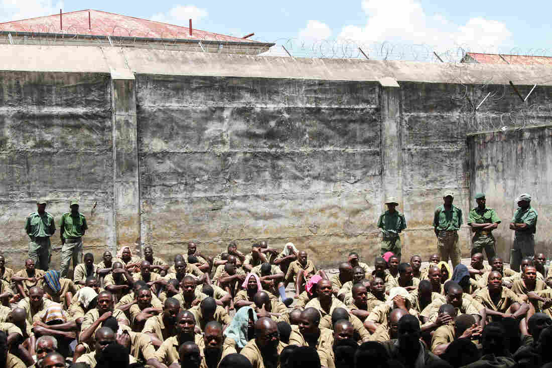 In this 2014 photo, prisoners are closely guarded at Chikurubi Maximum Prison in Harare, Zimbabwe. According to state media, at least 200 male inmates were freed from this prison as a result of President Mugabe's pardons.
