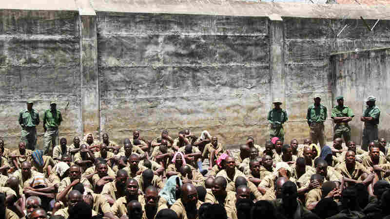 In this 2014 photo, prisoners are closely guarded at Chikurubi Maximum Prison in Harare, Zimbabwe. According to state media, at least 200 male inmates were freed from this prison as a result of President Robert Mugabe's pardons.