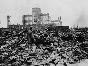 One month after the atomic bomb was dropped on Hiroshima, a man stands amid ruins left by the explosion. The structure seen standing became the Hiroshima Peace Memorial, which President Obama visited Friday.