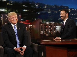 Republican presidential candidate Donald Trump (left) talks with host Jimmy Kimmel during a taping of the ABC television show Jimmy Kimmel Live!