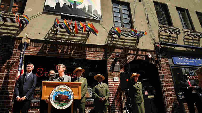 Secretary of the Interior Sally Jewell speaks in front of the Stonewall Inn in 2014 to announce a National Park Service initiative to identify historic sites related to the struggle for LGBT rights.