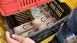 In Venezuela, Devalued Money May Weigh More Than Whatever You Can Buy