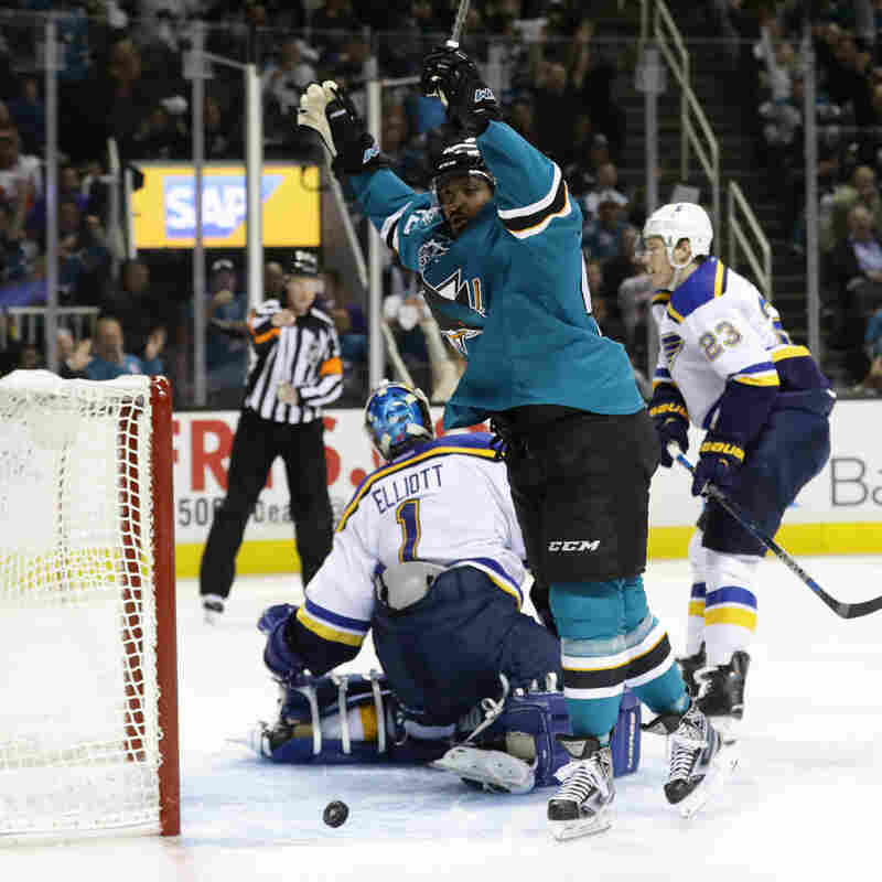 Joel Ward of the San Jose Sharks celebrates after scoring his second goal Wednesday in San Jose against Brian Elliott and the St. Louis Blues in the Western Conference Finals.