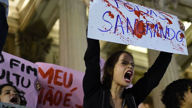 Brazilians protest in front of the Legislative Assembly of Rio de Janeiro on Friday against an alleged gang rape that police say they are investigating. (AFP/Getty Images)