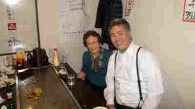 Kikue Takagi, left, narrowly survived the Hiroshima atomic bombing as a schoolgirl. She's now 84. Her second cousin is U.S. Rep. Mark Takano, a Democrat from southern California. His grandparents and parents were all placed in U.S. internment camps in World War II. In this photo from last year, they are at a restaurant in Hiroshima, where he visited her.