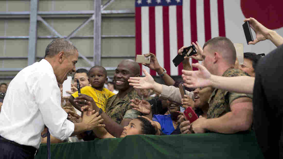 President Barack Obama greets members of the U.S. and Japanese military as he arrives to speak at Marine Corps Air Station Iwakuni in Iwakuni, Japan.