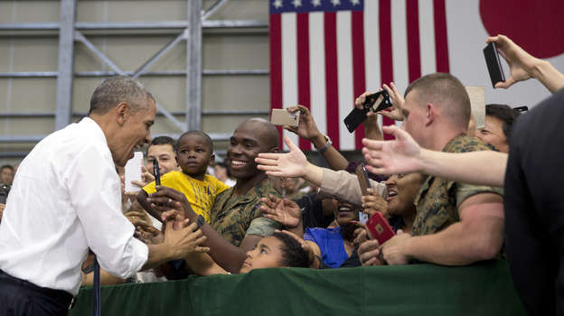 President Barack Obama greets members of the U.S. and Japanese military as he arrives to speak at Marine Corps Air Station Iwakuni in Iwakuni, Japan. (AP)