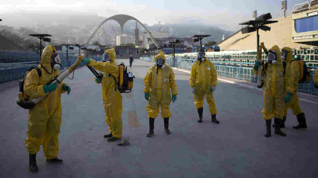 Health workers get ready to spray insecticide to combat the Aedes aegypti mosquitoes that transmits the Zika virus in January, under the bleachers of the Sambadrome in Rio de Janeiro, which will be used for the Archery competition in the 2016 summer games.