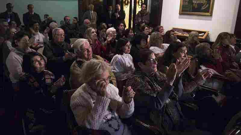 Relatives and victims of Argentine and Uruguayan military dictatorships react as they hear the sentence of Argentina's court in the trial on Operation Condor, at the Argentina's embassy in Montevideo, Uruguay on May 27, 2016.