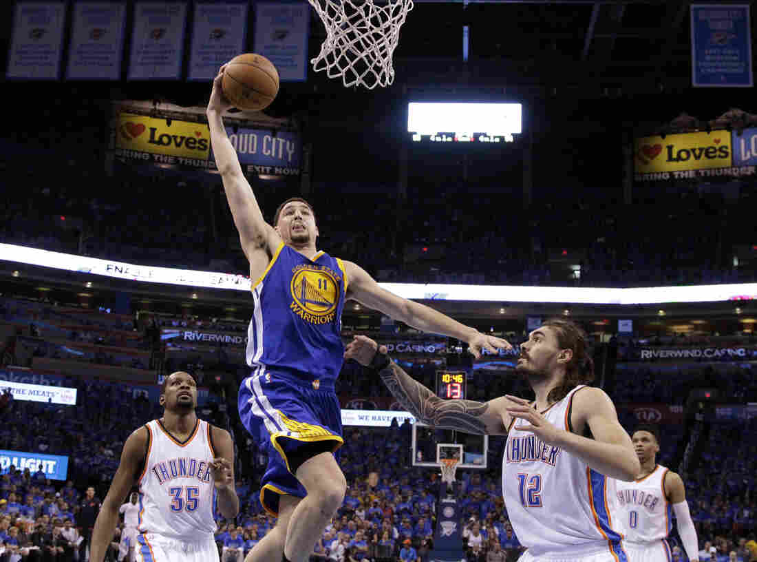 Golden State Warriors guard Klay Thompson (11) shoots over Oklahoma City Thunder center Steven Adams (12) during the second half of Game 6 of the NBA basketball Western Conference finals in Oklahoma City on Saturday. The Warriors won 108-101.