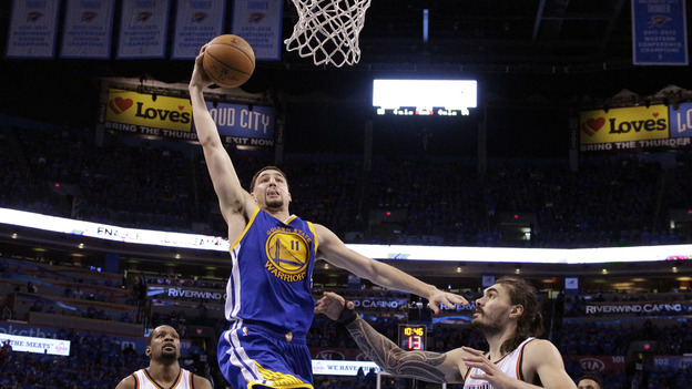 Golden State Warriors guard Klay Thompson (11) shoots over Oklahoma City Thunder center Steven Adams (12) during the second half of Game 6 of the NBA basketball Western Conference finals in Oklahoma City on Saturday. The Warriors won 108-101. (AP)
