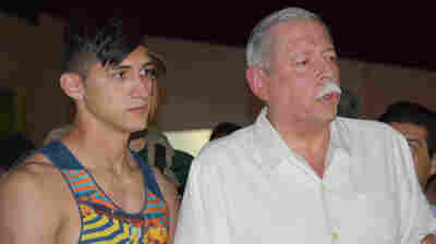Mexican soccer player Alan Pulido, left, stands next to Tamaulipas State Gov. Egidio Torre Cantu after Pulido was rescued from kidnappers on Monday.