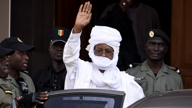 Hissene Habre, the former president of Chad, waves as he leaves a courthouse in Dakar, Senegal, on June 3. Habre was ousted from Chad in 1990 and has lived in exile in Senegal ever since. (AFP/Getty Images)