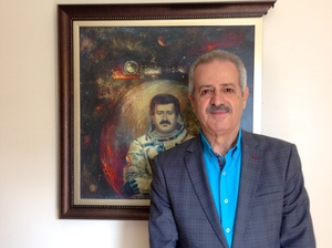 Syria's Mohammed Faris was a national hero after he became the country's first cosmonaut in 1987, traveling on the Soviet Union's Mir Space Station. Now he's a refugee in Istanbul, Turkey. Faris, 65, is shown standing in front of a painting of himself as a cosmonaut. A critic of Syria's President Bashar Assad, he still hopes to return to his homeland.