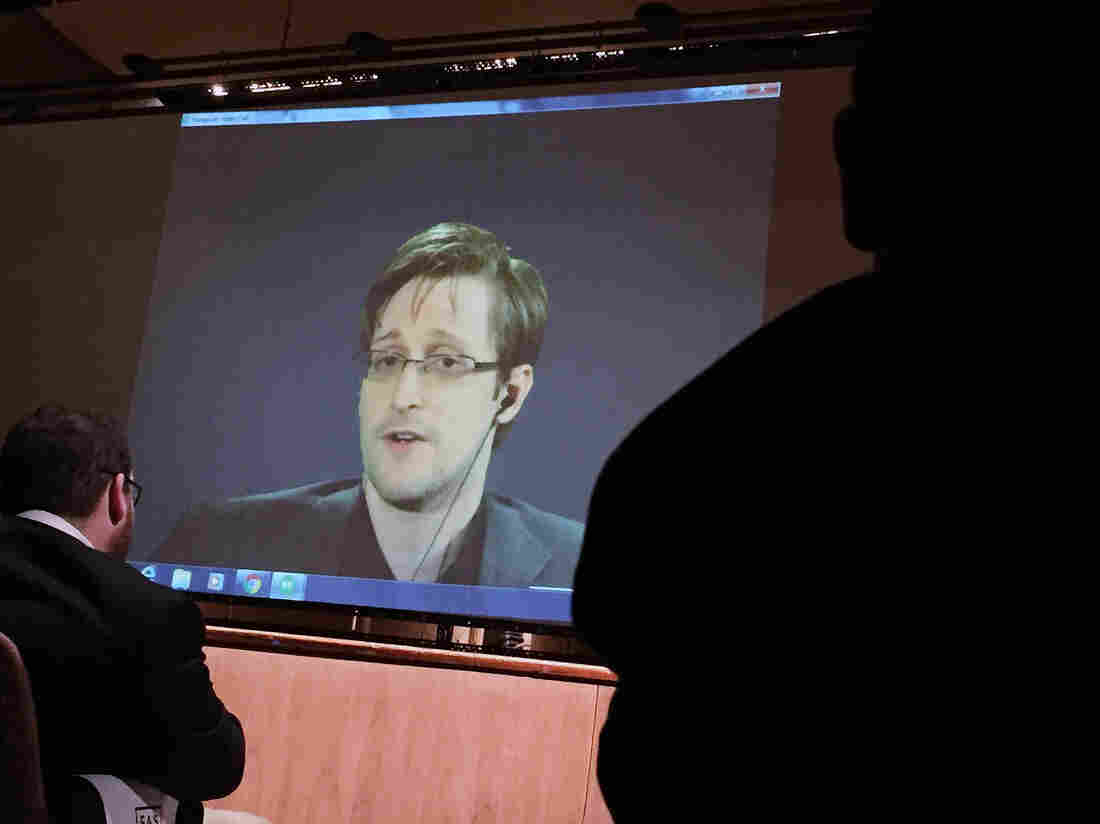 Former National Security Agency contractor Edward Snowden, center speaks via video conference at Johns Hopkins University in February.