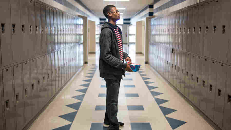 Robert Gordon pauses in the hallway of North Middle/High School while distributing letters to students regarding their ACT tests.