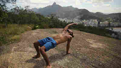 A man performs yoga in the Babilonia favela overlooking Rio de Janeiro in 2014. The Brazilian government made a big push to impose order on the shantytowns in advance of the World Cup in 2014 and the Olympics this summer. Babilonia was once considered a model, but violence has been on the rise in the run-up to the games.