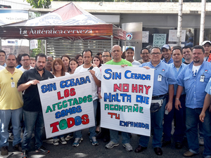 Furloughed Polar workers picket outside the Polar's Caracas brewery, which shut down in April. They are protesting against the government which has impeded Polar's ability to import barley.