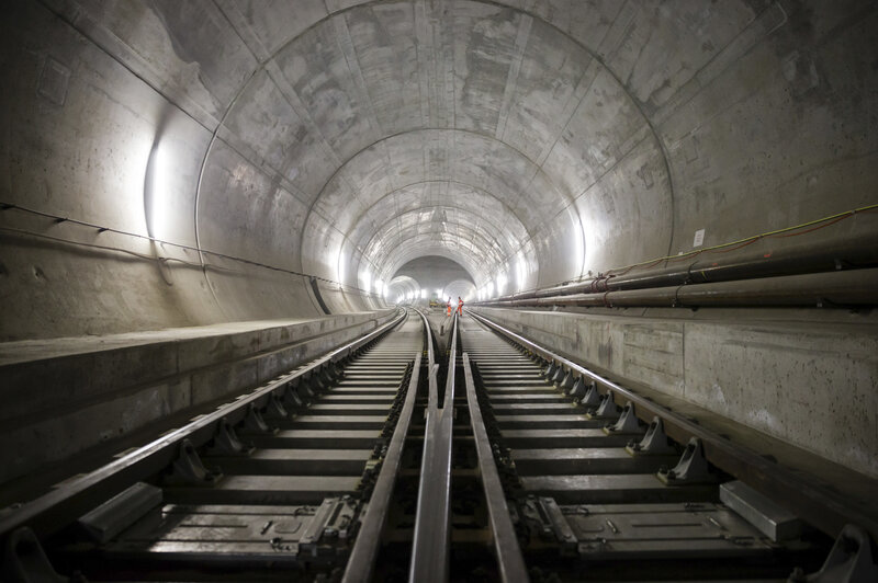Train tracks lead toward an access tunnel inside the east section of the Gotthard Base Tunnel in Faido, Switzerland, in 2014. The tunnel had its opening ceremony on Wednesday.