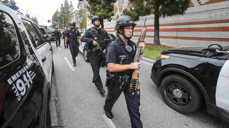 Police officers work at the scene of a fatal shooting at the University of California, Los Angeles, on Wednesday.