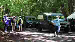 Japan's Self-Defense Forces, whose vehicles are seen here during the search for a young boy on Japan's northern island of Hokkaido, reportedly found a small boy who identified himself as the boy they'd been looking for since Saturday.