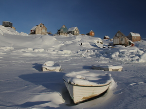 Ice-bound fishing boats in the harbor at Tiniteqilaaq, Greenland. Only about 50 people live in what was once a great hunting community.