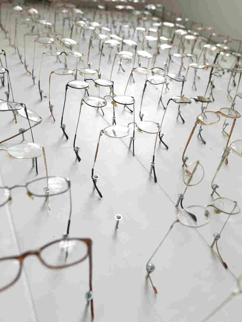 The glasses represent members of the Heaven's Gate religious group. In 1997, 39 members of the group committed mass suicide.