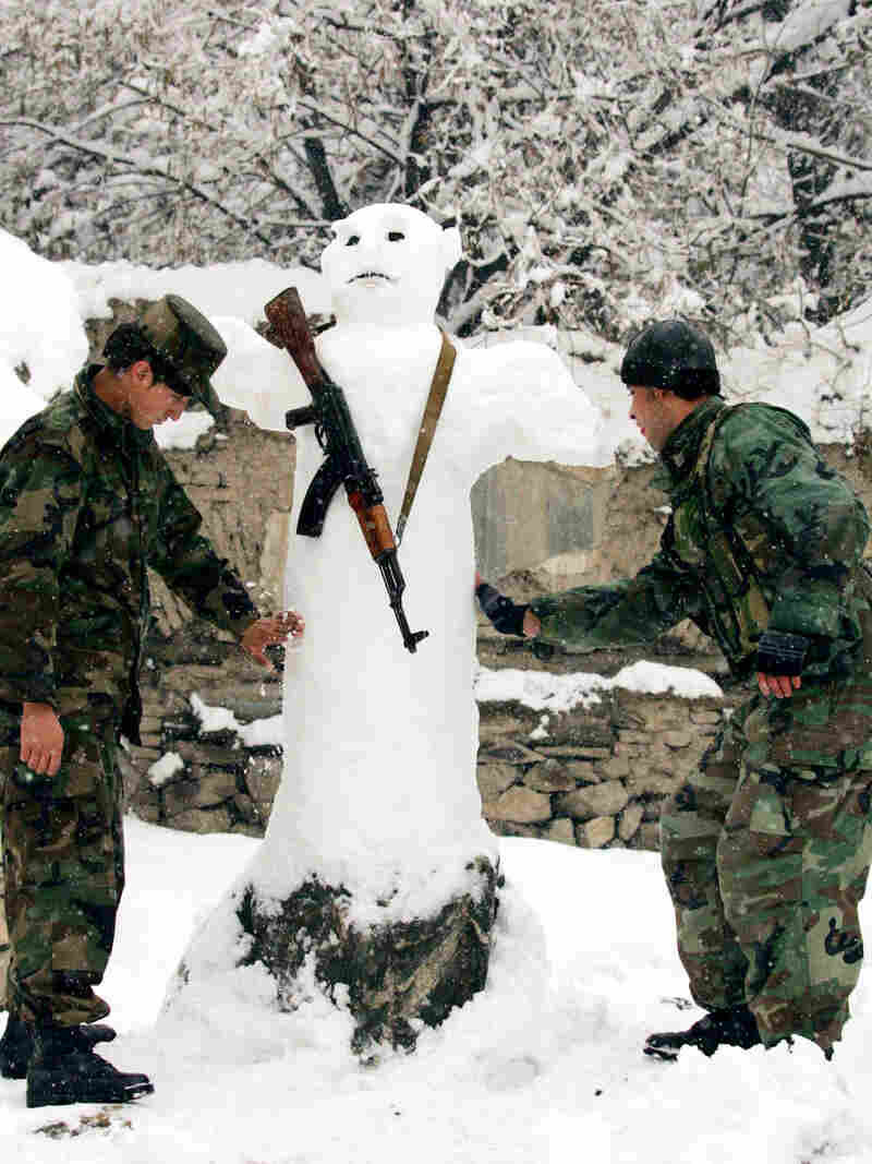 In this photo released by China's Xinhua news agency, Afghan soldiers make a snowman after a heavy snowfall in Kabul, Afghanistan, on Dec. 26, 2006.