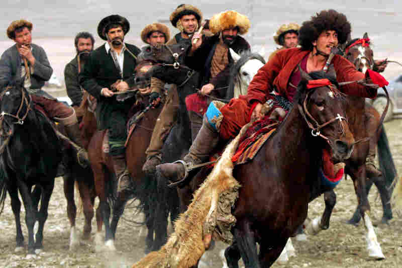 "Afghan horsemen play a game of Buzkashi in Kabul on March 2, 2007. Buzkashi, literally translated as ""goat grabbing,"" is Afghanistan's traditional and national sport. In Buzkashi, a carcass of goat is placed in the center of a circle and surrounded by the players from two opposing teams. The object of the game is to get control of the carcass and bring it to the scoring area."