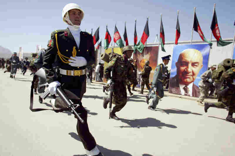 Afghan soldiers run to the scene after an attack at a military parade in Kabul, Afghanistan, on April 27, 2008. Suspected Taliban militants attacked a ceremony attended by the Afghan president, unleashing automatic weapons and rocket fire that sent foreign dignitaries and senior members of the government fleeing for cover. Three people were killed and eight wounded in the attack.