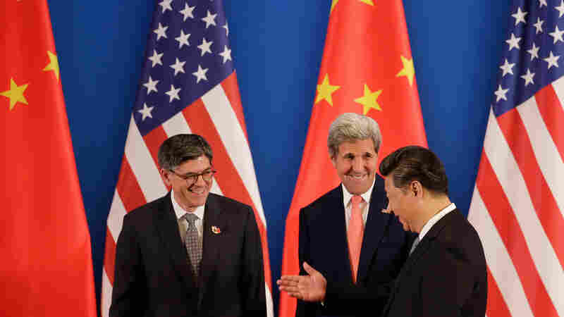 China's President Xi Jinping (right), chats with U.S. Secretary of State John Kerry (center), and U.S. Treasury Secretary Jacob Lew during the joint opening ceremony of the U.S.-China Strategic and Economic Dialogues in Beijing on Monday.