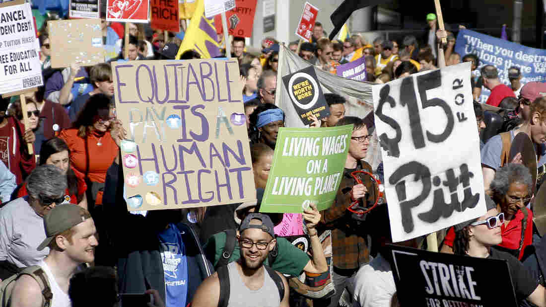 Union organizers, students, and supporters for a $15 an hour wage march in Pittsburgh in April. Washington, D.C., is the latest city to move toward the wage increase.