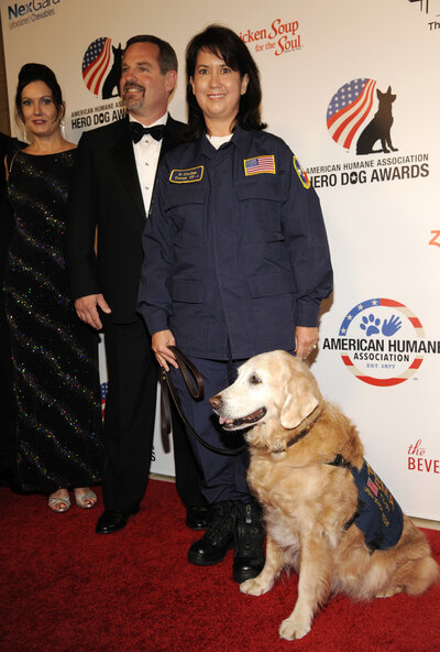 "Bretagne, shown with handler and owner Denise Corliss and her husband, Randy Corliss, was a finalist at the American Humane Association's 2014 ""Hero Dog Awards"" in Beverly Hills, Calif."