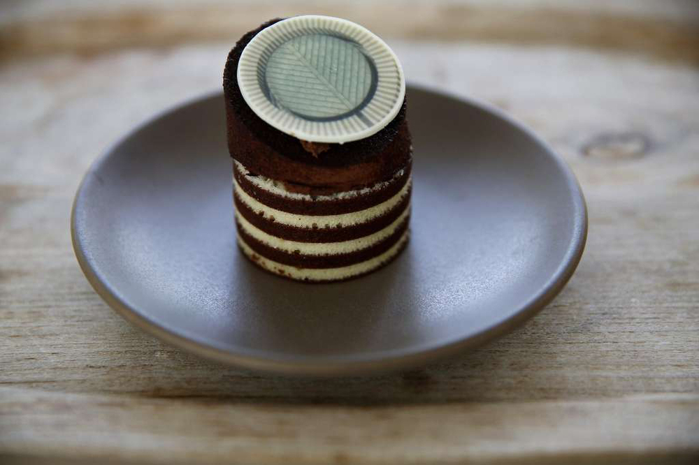 The Oculus cake now being sold by the new caterer running the SFMOMA's upstairs cafe. The cake was inspired by the distinctive tower at the San Francisco Museum of Modern Art. It is similar in design and spirit to a cake prepared by Caitlin Freeman and her baking team for a museum event several years ago. (See below.)