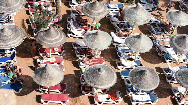 Tourists sunbathe in a resort in Sharm el-Sheikh. Tourism has fallen dramatically since a Russian jet crashed after taking off from the town last November.