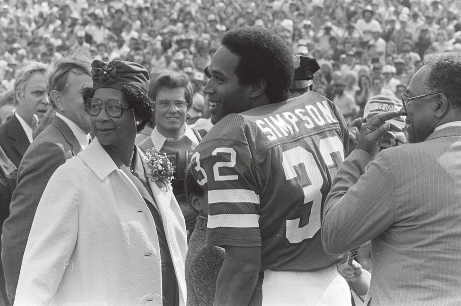 O.J. Simpson with his mother, Eunice, and father, Jimmy Lee, on the field at Rich Stadium for his induction into the Buffalo Bills Wall of Fame in 1980. (Mickey Osterreicher via ESPN)