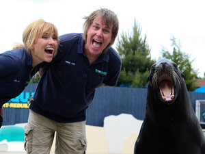 Hans Walters and his wife, Martha Hiatt, rock out with a sea lion named Bruiser.