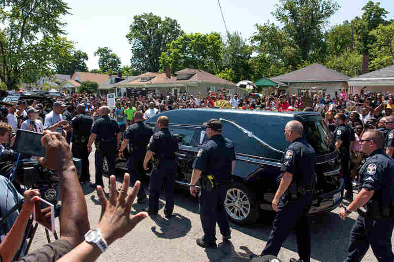 The hearse carrying Muhammad Ali drives along in the funeral procession motorcade on Grand Avenue in the front of Ali's childhood home in Louisville, Ky. The funeral procession for Ali was traveling over 20 miles on a designated route throughout Louisville on the way to Cave Hill Cemetery. The four-time world heavyweight boxing champion died on June 3 at age 74.
