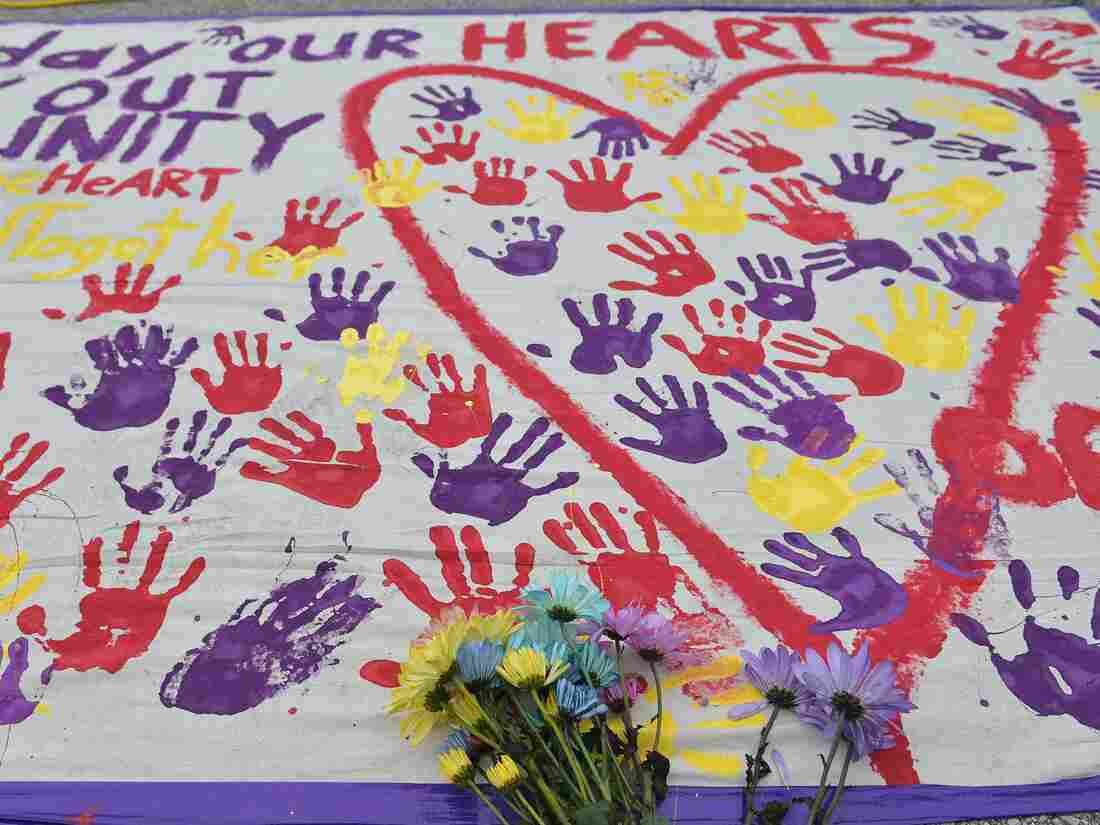 A makeshift memorial with flowers and handprints rests in a parking lot near the Pulse nightclub in Orlando, Fla.