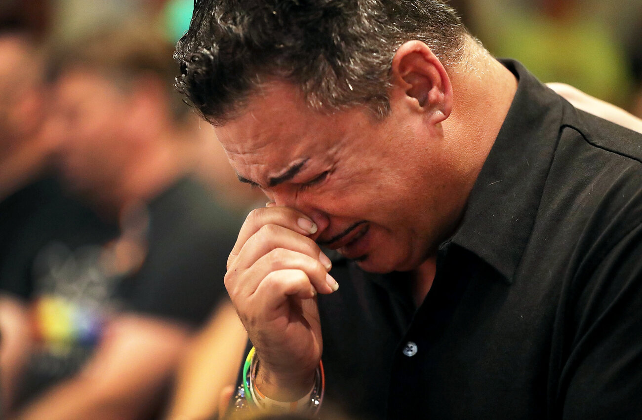 Orlando (who did not want to provide his last name), who was injured in the mass shooting at the Pulse Nightclub, cries as he attends a memorial service at the Joy MCC Church for the victims of the mass shooting.