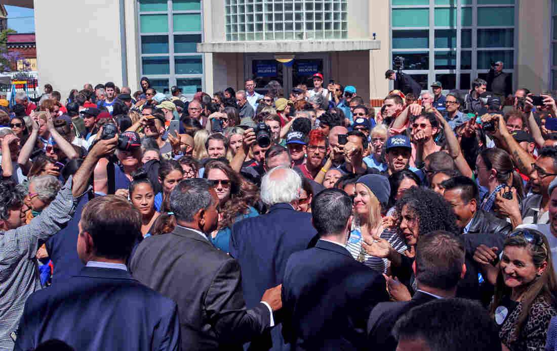 Sen. Bernie Sanders (center) reaches out to supporters after speaking at a get-out-the-vote canvass launch at the City College of San Francisco ahead of last week's California primary.