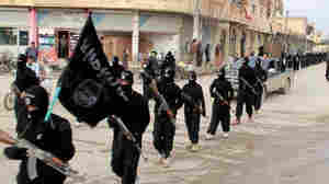 Fighters from the al-Qaida linked Islamic State of Iraq and the Levant (ISIL) marching in Raqqa, Syria. (AP Photo/Militant Website, File)