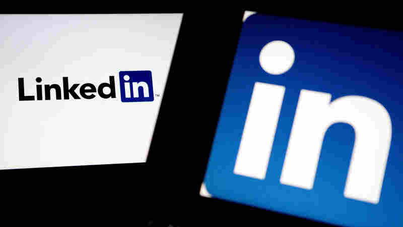 LinkedIn logos are displayed on laptop computers for an illustration.