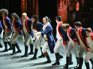 Lin-Manuel Miranda, center, and the cast of Hamilton perform at the Tony Awards at the Beacon Theatre on Sunday. The smash hit musical was nominated for 16 awards and won 11.