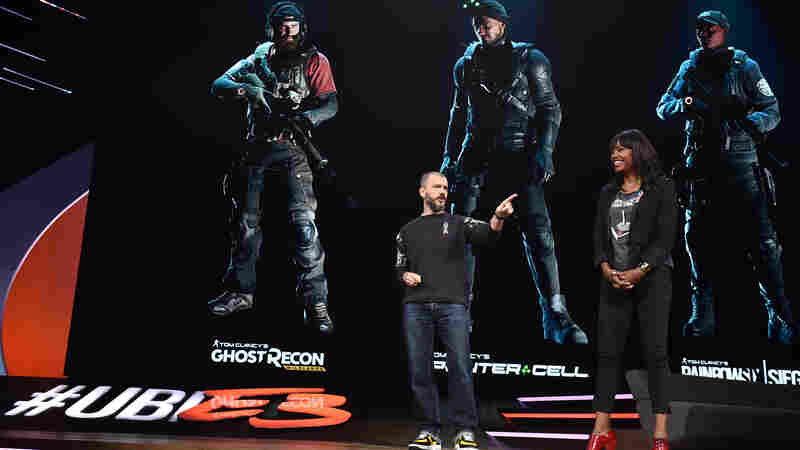 Julian Gerighty of the video game maker Ubisoft and actress Aisha Tyler speak at a press conference during the E3 video game trade show in Los Angeles.