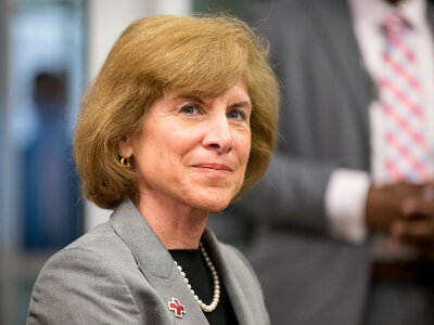 American Red Cross President and CEO Gail McGovern attends a roundtable with President Obama regarding the 10th anniversary of Hurricane Katrina in New Orleans on Aug. 27, 2015.