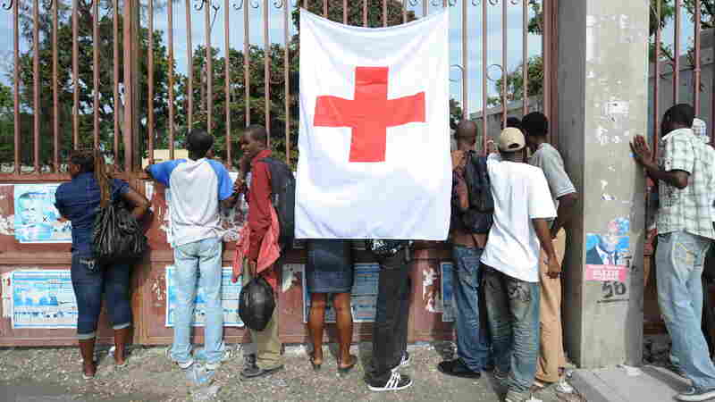 Haitians outside a Red Cross field hospital in Carrefour, Haiti, on Dec. 14, 2010, 11 months after a magnitude 7.0 earthquake hit the country's capital, Port-au-Prince.